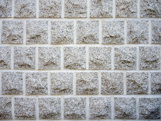 wall of  gray rectangular stones as background