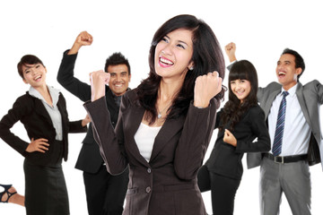 Young asian businesswoman with her team behind, make a success g
