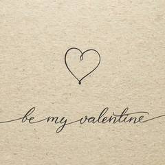 Be my Valentine for Valentines day. Calligraphy lettering on cardboard.