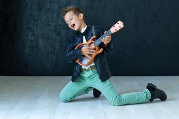 A stylish boy with guitar
