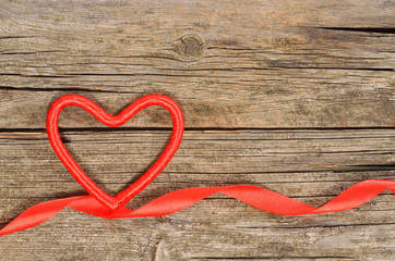 Decorative heart and ribbon on wooden table. Top view, copy space. Valentines day concept