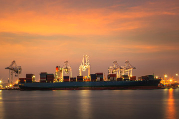 Fototapete - container ship in import,export port against beautiful morning light of loading ship yard use for freight and cargo shipping vessel transport