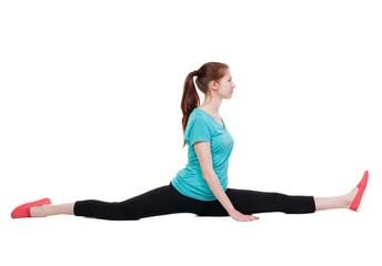 side view of the girl in sportswear sitting on  splits.