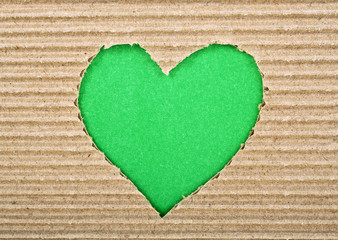 Green heart cut from corrugated cardboard