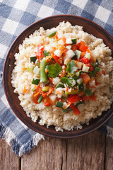 Asian Couscous with vegetables close-up. vertical top view