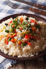 Arabic cuisine: couscous with vegetables close-up. Vertical