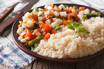 Vegan couscous with vegetable on a plate closeup. horizontal