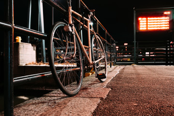 Parked bicycle at night front view.