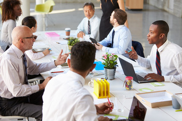African American Businessman At Meeting With Colleagues