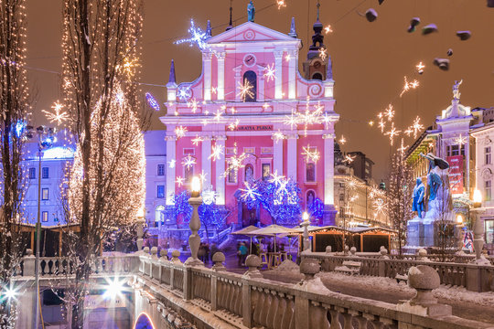 Ljubljana, Slovenia - January 3, 2016. Central city Preseren Square with christmas tree and lights crowded by celebrating people.