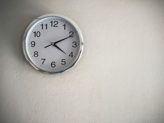 Clock on the white wall