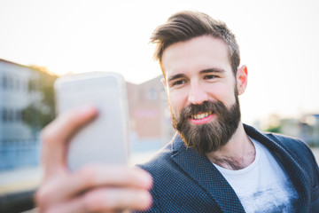 Half length of young handsome caucasian bearded brown hair man h