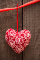 Valentines day background with handmade toy heart on wooden back