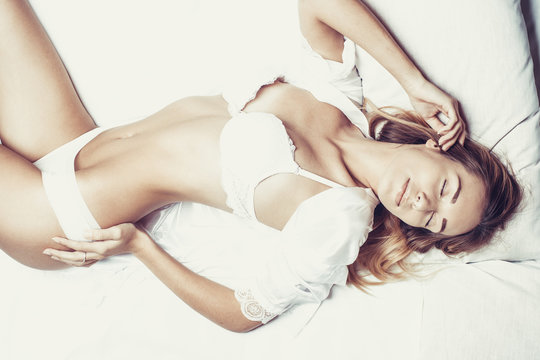 Fashionable photo of young sexy lady wearing white lingerie, amazing body.