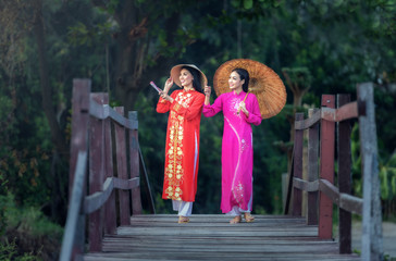 Portrait of Vietnamese girl traditional dress, Ao dai is famous traditional costume for woman in Vietnam