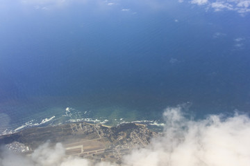 Aerial view of the California coast deep blue water with clouds