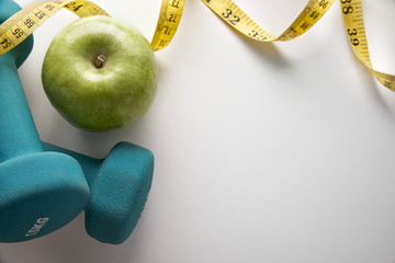 Dumbbells with apple and tape measure top