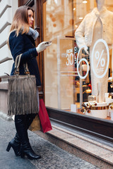 Elegant woman looking at boutique showcase