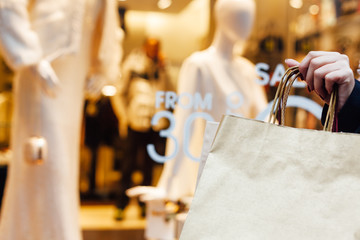 Closeup of woman holding shopping bag