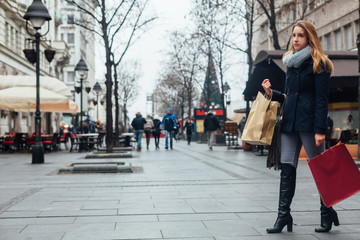 Woman walking on the street after buying
