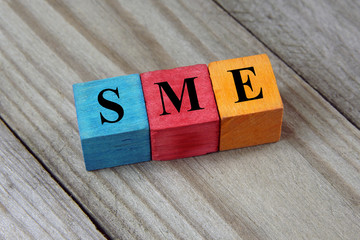 SME text (Small Medium Enterprises) on colorful wooden cubes