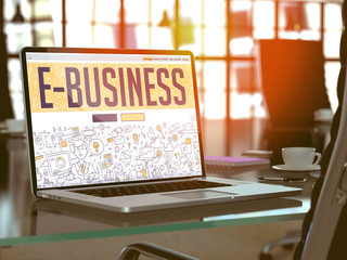 E-business on Laptop in Modern Workplace Background.