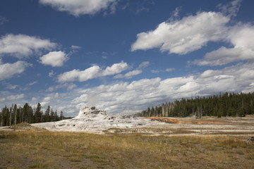 White limestone of Castle Geyser with deep blue sky, Yellowstone.