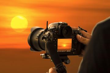 Photographers shooting the sun