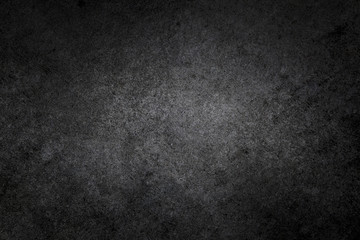 Dark textured black grunge background