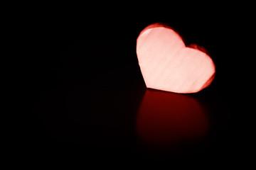 heart shape paper on black