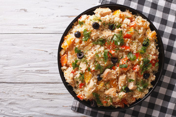 couscous with chicken, olives and vegetables. Horizontal top view