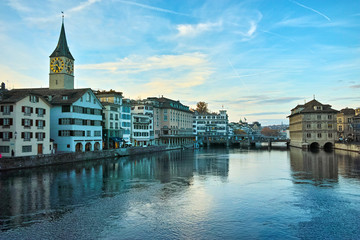 Sunset over  city of Zurich and reflection in Limmat River, Switzerland