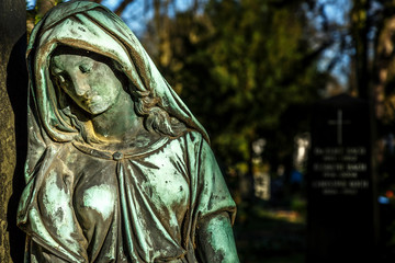 Mother Mary Christianity Religion in Cemetery Graveyard in Nature