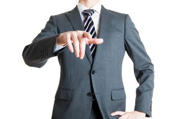 カメラに向かって指を指しているビジネスマン,白背景