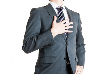 手を胸に当てているビジネスマン,白背景