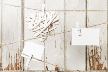 Paper cards with clothes pins hanging on a string