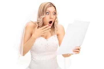 Shocked bride looking at a bill
