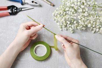 Florist at work. How to make gypsophila paniculata wedding wreat