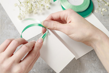 Florist at work. How to make napkin ring with chrysanthemum flow