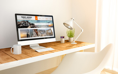 minimalist workplace and computer with travel website