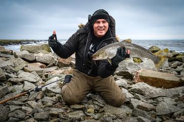 Man enjoy sea trout winter fishing