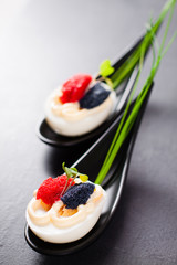 Appetizer on fingerspoon egg with caviar