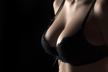 beautiful big female breasts in a bra