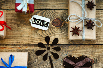 Gift boxes, heart shape and label with word Love