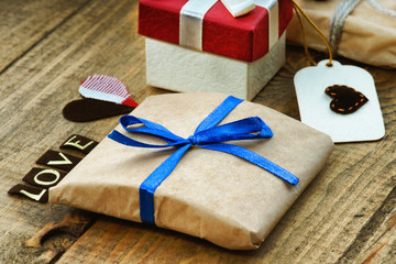 Gift boxes, heart shape and word Love