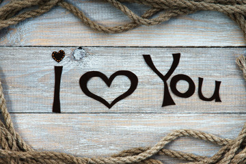 Frame made of rope, heart shape and words I You