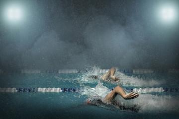 Swimmers in waterpool.