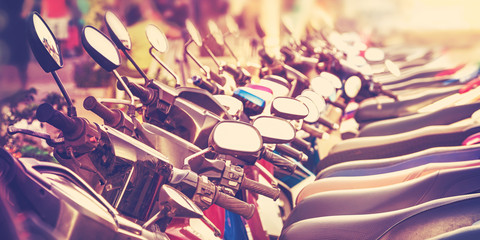 Vintage stylized picture of scooters in a row.