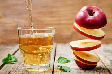 flying slices of apple and apple juice