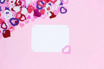 Blank white sign with collection of colorful hearts